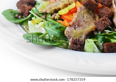 salad of marinated pork, spinach and buckwheat