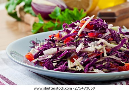 Salad of red and white cabbage and sweet red pepper, seasoned with lemon juice and olive oil in bowl - stock photo