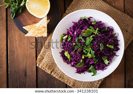 Salad of red cabbage with herbs. Top view - stock photo