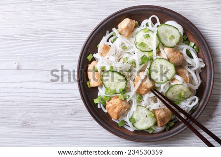 salad of rice noodles with chicken and cucumbers close-up. horizontal view from above  - stock photo