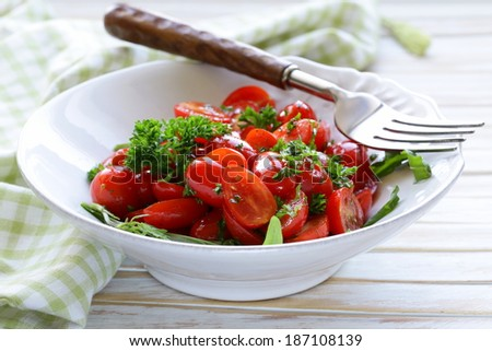 salad of small cherry tomatoes with parsley and olive oil - stock photo