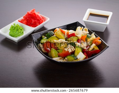 salad of tomatoes, cucumbers, asparagus, red pepper dressed with olive oil - stock photo