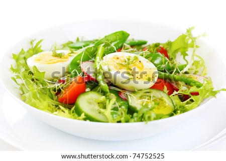 salad of tomatoes, cucumbers, asparagus, young green peas dressed with olive oil and watercress salad - stock photo
