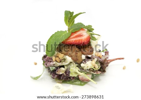 salad of vegetables and meat on a white background - stock photo