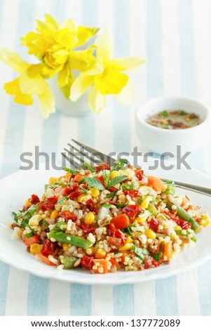 Salad of whole grain with summer vegetables - stock photo