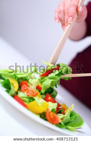 Salad on a white plate, shallow DOF