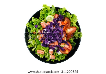 salad on black plate top view on white background.  - stock photo