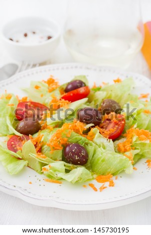 salad on the plate with glass of wine
