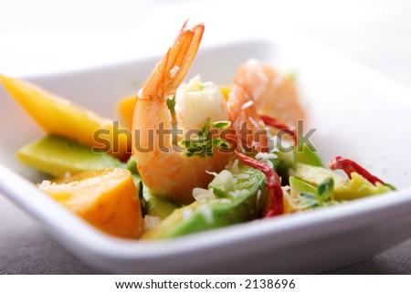 salad or apetizer with shrimp,coconut,avocado mango and herbs - stock photo
