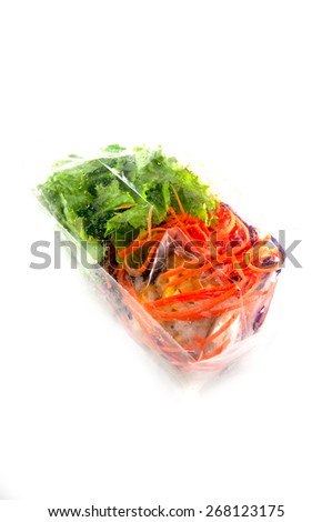 Salad pack in plastic bags on white - stock photo