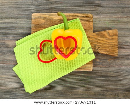 Salad pepper with cut in shape of heart on table close up - stock photo
