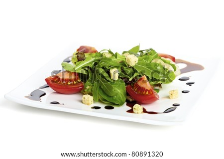 Salad plate garnished with balsamic vinegar - stock photo