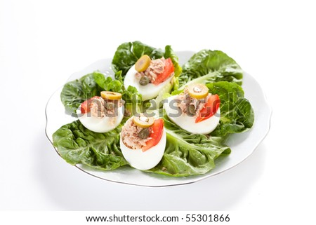salad plate of lettuce egg tuna and olive - stock photo