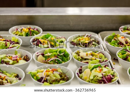 Salad prep in an industrial kitchen - stock photo