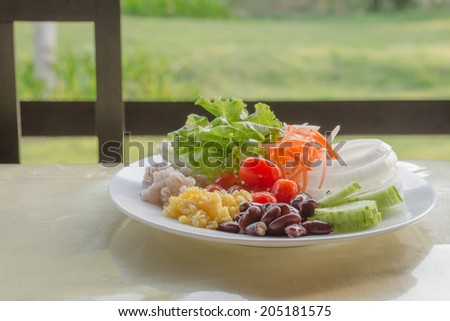 Salad promotes healthy morning meal. - stock photo