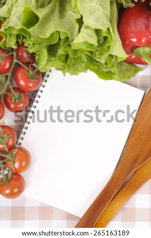 Salad, recipe book, top view, vertical - stock photo