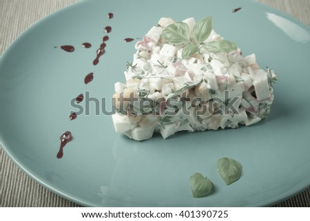 Salad serving by strokes of different sauces. Toned. - stock photo