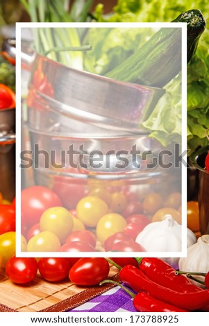 Salad, tomatoes and other veggies in metal cookware - stock photo