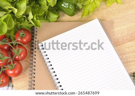 Salad vegetable, recipe book, copy space - stock photo