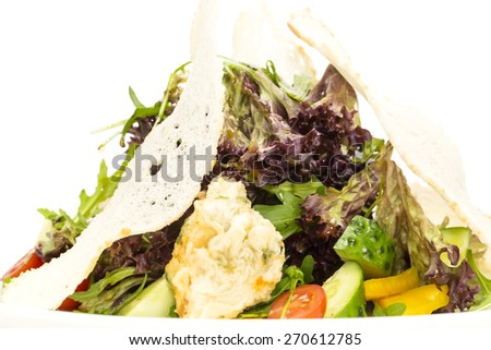 salad vegetables and goat cheese on a white background