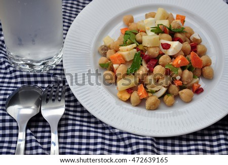 salad vegetables and legumes and ice water with bubbles