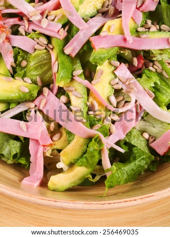 Salad with avocado and ham