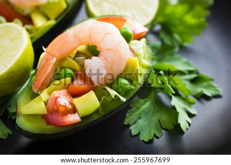 Salad with avocado, fresh  vegetables and shrimps - stock photo