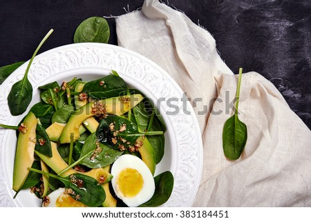 salad with avocado, grapefruit and spinach. selective focus - stock photo