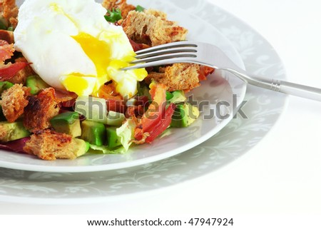 Salad with bacon and avocado and boiled egg