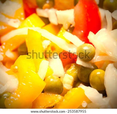 salad with bell peppers, cabbage, tomatoes and green peas. close up