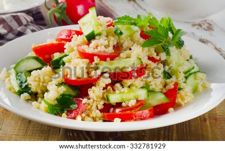 Salad with bulgur, parsley and vegetables. Selective focus - stock photo