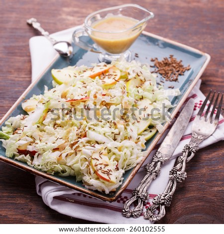 Salad with cabbage with Apple and caraway flavored sauce..selective focus - stock photo