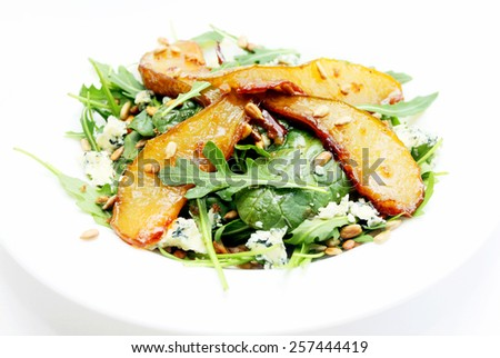 Salad with caramelized pears, sunflower seeds and blue cheese - stock photo