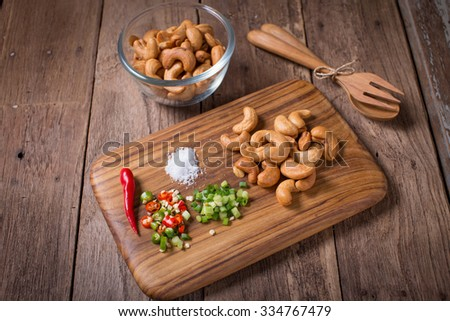 Salad with cashew nuts with chilli , salt and spring onion. - stock photo