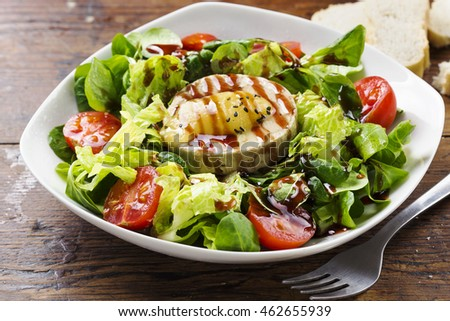 Salad with cheese and tomatoes