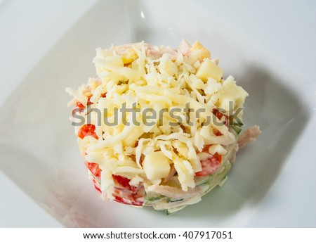 salad with cheese, vegetables, egg, ham - stock photo
