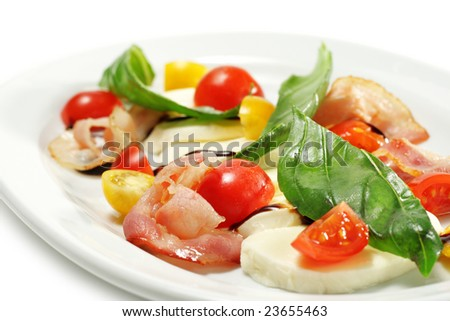 Salad with Cherry Tomato, Buffalo Cheese, Bacon and Vegetable Leaf. Isolated on White Background