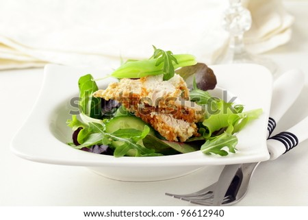 salad with chicken and vegetables, peas and herbs