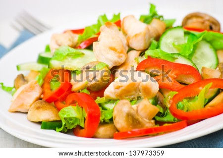 salad with chicken, mushrooms and vegetables - stock photo