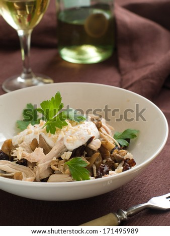 Salad with chicken, mushrooms,  prune and nut, selective focus - stock photo