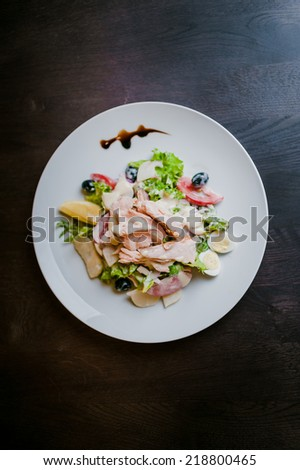 salad with chicken, smoked salmon and potato chips - stock photo