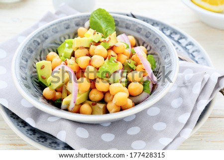 salad with chickpeas and avocado, food closeup - stock photo