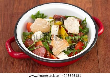salad with chorizo and bread - stock photo