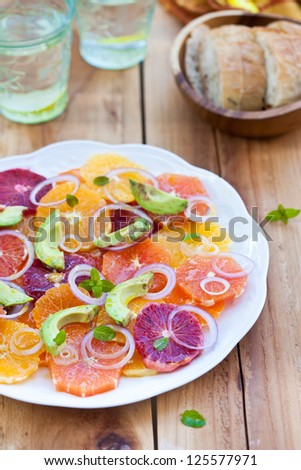 Salad with Citrus Fruits, Avocado and Onion. Ready-to-eat. Also available in horizontal format. - stock photo