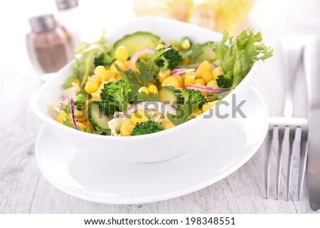 salad with corn and cucumber - stock photo