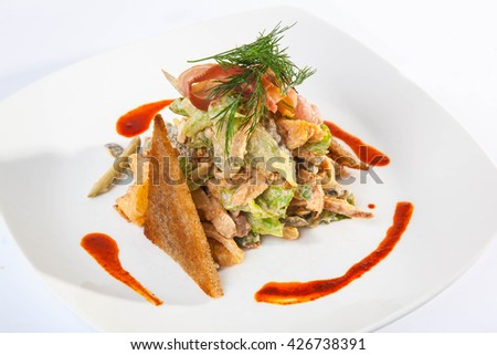 Salad with croutons and dressing red sauce - stock photo