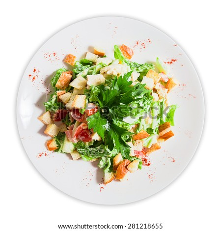 salad with croutons and greens on a plate - stock photo