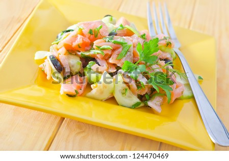 salad with cucumber and salmon - stock photo