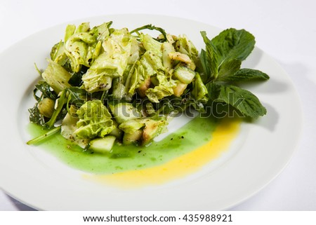 Salad with cucumber and salmon and mint - stock photo