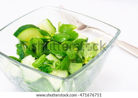 Salad with Cucumber, Purslaneon White Background  Studio Photo